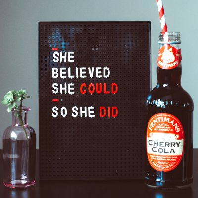 She believed she could so she did sign with cherry cola and flower.
