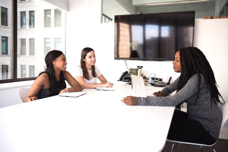 African American CEO meeting with employees