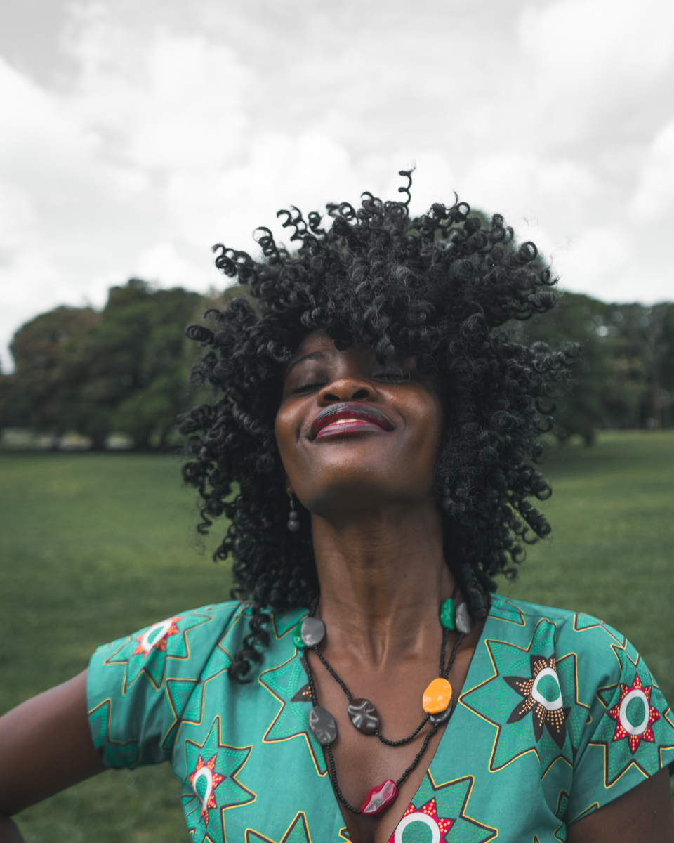 beautiful-african-woman-curly-hair-smile-photo-by-miguel-bruna-on-unsplash